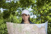 White Cap Woman Watching Map