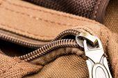 Bag with open zipper