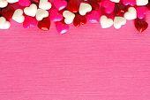 Pink Valentines Day background with candy border
