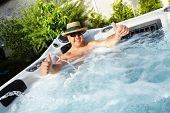 stock photo of tub  - Man having massage in  hot tub Jacuzzi - JPG