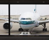 Cathay Pacific Passenger Airplane At The Airport