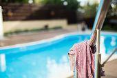 Shirt heft near the swimming pool