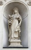 VIENNA, AUSTRIA - OCTOBER 10: Saint Rose of Lima on the facade of Dominican Church in Vienna, Austria on October 10, 2014. Famous baroque church was completed in 1634.