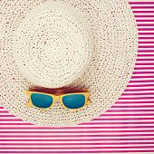 Plastic Sunglasses On A Laced Summer Hat For Women
