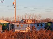 picture of caboose  - a old caboose sits forgotten on a siding - JPG