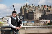 Scottish Bagpiper In Edinburgh