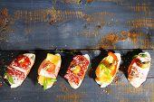 stock photo of sandwich  - Tasty sandwiches on wooden table - JPG