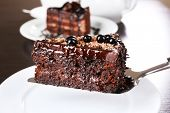 Yummy chocolate cake served on table, close-up