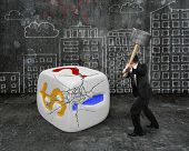 Businessman Holding Sledgehammer Hitting Large Dice With Buildings Doodles
