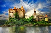 picture of chateau  - fairy castle on lake over sunset  - JPG