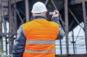 Engineer filmed with camcorder in factory