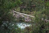 Suspended bridge for pedestrians.