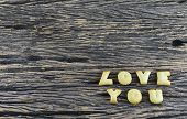 Love You On Wooden Background