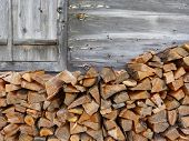 picture of wood pieces  - A stack of firewood at the ski lodge - JPG
