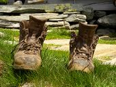 old hiking boots in the grass