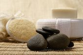 zen stones and spa set on the wood for treatments