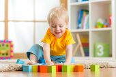stock photo of kindergarten  - kid boy playing  wooden toys at home or kindergarten - JPG