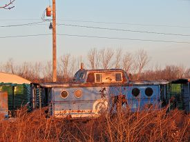 stock photo of caboose  - a old caboose sits forgotten on a siding - JPG