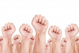 stock photo of union  - Labour movement workers union strike concept with male fists raised in the air fighting for their rights - JPG