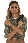 image of camo  - A woman in her camo jacket with her pistol up by her shoulder - JPG