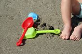 picture of children beach  - Child playing in sand - JPG