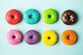 foto of donut  - Colorful donuts on a blue background - JPG