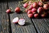 image of red shallot  - Shallot onions on old wooden table with shadow - JPG