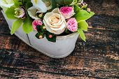 foto of vase flowers  - Flowers decoration of roses in vase on wooden table - JPG