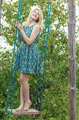 picture of swing  - Fill length portrait of blonde girl in blue silk sundress on handmade swing - JPG