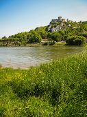 image of yellow castle  - Scenic ruins of an ancient castle on the river shore Les Andeles France - JPG