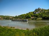 pic of yellow castle  - Scenic ruins of an ancient castle on the river shore Les Andeles France - JPG