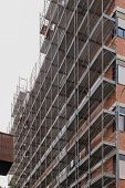 pic of scaffold  - Scaffolding construction of a building for renovation - JPG