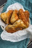 picture of crisps  - Crisp crunchy golden chicken wings on a dark table - JPG