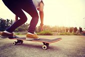 image of skateboard  - young asian skateboarder legs riding on skateboard outdoor - JPG