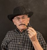 foto of hillbilly  - Cowboy in hat with Pipe  - JPG