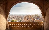 stock photo of rajasthani  - Town and fort view from the window in City Palace museum of Jaisalmer Rajasthan India - JPG