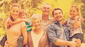 pic of extended family  - Portrait of an extended family smiling at the park - JPG