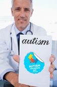 foto of prescription pad  - The word autism and portrait of a male doctor showing a blank prescription sheet against autism awareness day - JPG