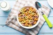 stock photo of cereal bowl  - the colorful cereal rings in bowl - JPG