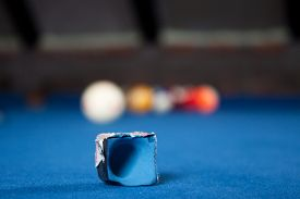 stock photo of pool ball  - Billiard balls / A Vintage style photo from a billiard balls in a pool table. Noise added for a film effect