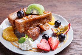 stock photo of french toast  - French toast and fresh fruit with caramel sauce - JPG