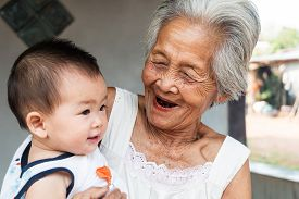 stock photo of grandmother  - Asian Grandmother with baby great grandmother holding great grandchild - JPG
