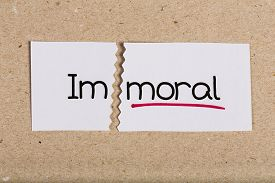 stock photo of moral  - Two pieces of white paper with the word immoral turned into moral - JPG