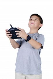 stock photo of helicopters  - Little boy holding a radio remote control  - JPG
