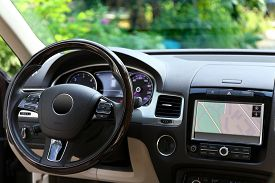 foto of steers  - Modern car illuminated dashboard and steering wheel - JPG