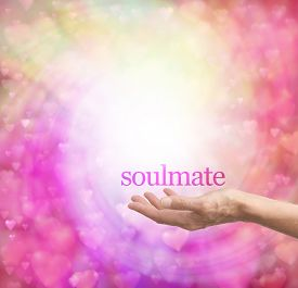 stock photo of soulmate  - Female hand palm up with the word Soulmate floating above - JPG