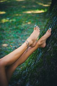 picture of barefoot  - barefoot female legs with ankle bracelet - JPG