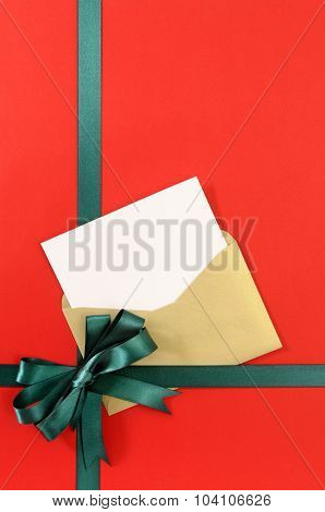 Open christmas or birthday card with green gift ribbon bow on plain open christmas or birthday card with green gift ribbon bow on plain red background paper copy space vertical poster id 104106626 m4hsunfo
