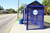 stock photo of bus-shelter  - Empty bus stop shelter on city sidewalk - JPG