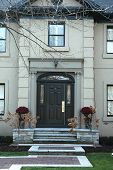 pic of front door  - home entrance with black door and stucco house - JPG